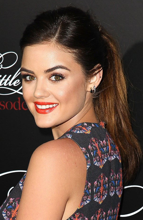 <p>Lucy proves a ponytail is anything but boring. Note the slight side part at the front.