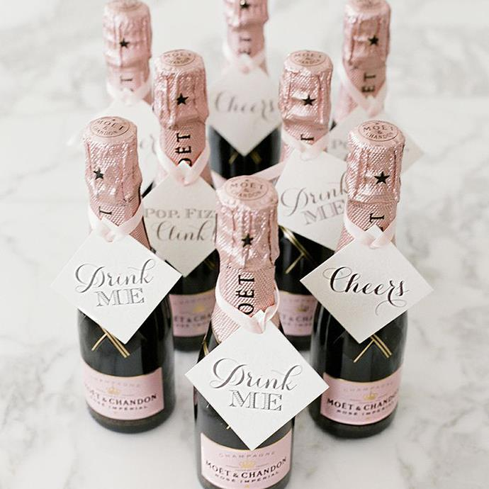"""<p> Champagne<p> <p> Even though bubbly will (hopefully) be on tap all night, a tiny bottle of champagne, wine or prosecco with a sweet note attached will have your guests leaving a little love-drunk. <p> Via <a href=""""http://lesleemitchell.com/"""">Leslee Mitchell</a>."""