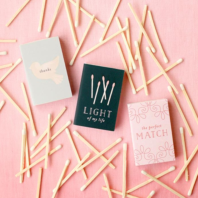 """<p> Matches<p> <p> Although not extravagant, this sweet little gift—which can be popped on top of plates or held in a container by the door—is useful and will be a nice reminder of your big day. (And they are totally DYI-able). <p> Via <a href=""""http://www.minted.com/julep/2014/03/07/matchbox-favor-printables/?utm_source=rss&utm_medium=rss&utm_campaign=matchbox-favor-printables"""">Minted</a>."""