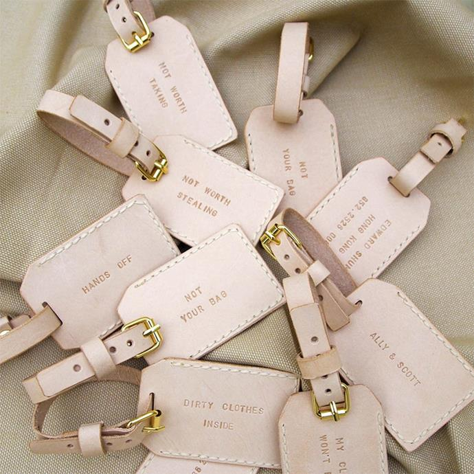 """<p> Luggage tags<p> <p> Did you splash out on a destination wedding? These luggage tags will make sure your guests remember their joy every time they get out their suitcase. <p> Via <a href=""""https://www.etsy.com/au/listing/63109497/personalized-luggage-tag-leather-luggage?ref=shop_home_active_27"""">HarLex</a>."""