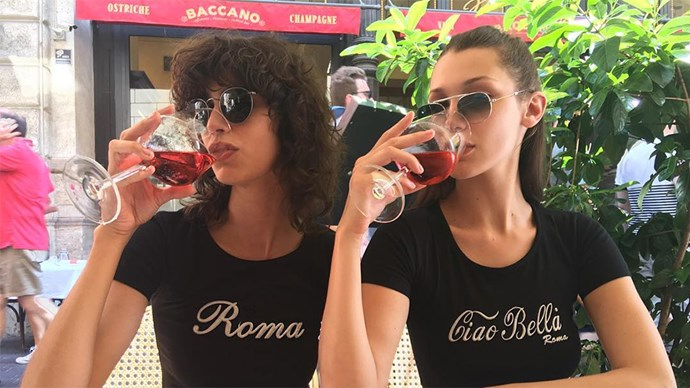 Bella Hadid Drinking Wine and Eating Pizza