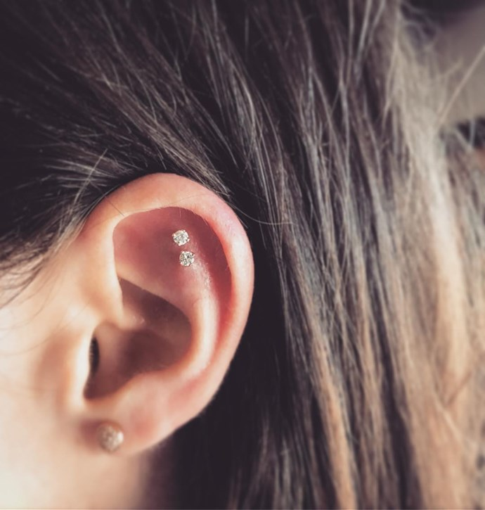 """<p>Two closely-placed piercings on the flat make a cool statement. Brian refers to this as a """"double outer conch."""" <p><a href=""""https://www.instagram.com/p/BLZc2s9Bcqg/"""" target=""""_blank"""">Instagram.com/bodyelectrictattoo</a>"""