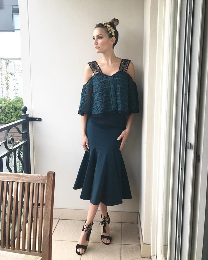 "<p>Rachael Finch is wearing a top and skirt combo by Jonathan Simkhai and Victoria Novak crown for Cup Day. <p><a href=""https://www.instagram.com/p/BMPl23Qj5jF/"">Instagram.com/rachael_finch</a>"