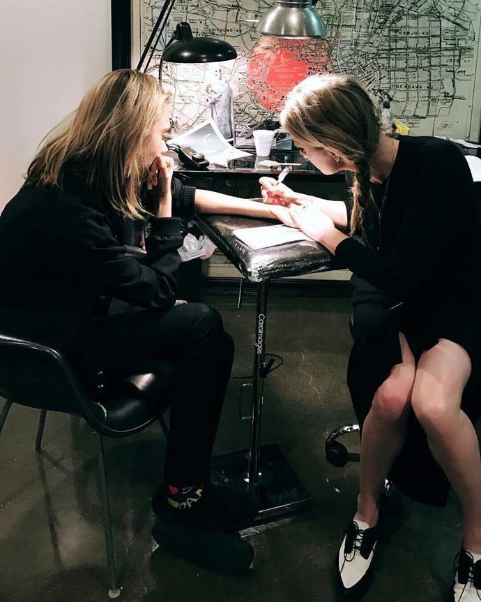 Cara Delevingne debuted a new tattoo yesterday, which she noted was designed by her good friend, Amber Heard.