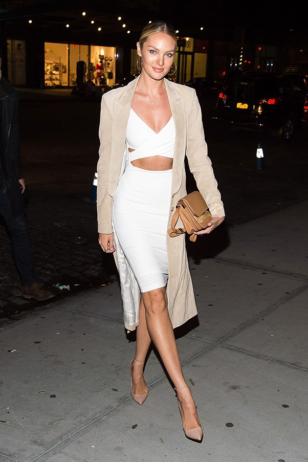 <p> <strong>Candice Swanepoel</strong><p> <p> Tone down the overt sexiness of a cut-out, figure-hugging dress with a knee-length coat, minimal make-up and a slick ponytail. Extra points to Candice for partnering white and beige.