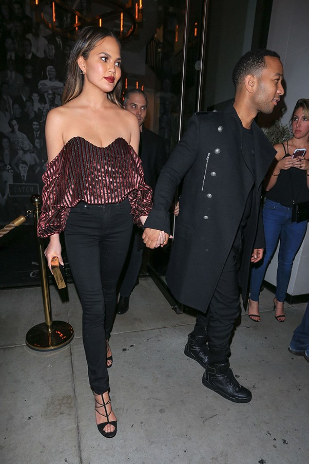 <p> <strong>Chrissy Teigen</strong><p> <p> If you're going to wear a statement top as incredible as this, you need to keep everything else to a minimum. Black skinny jeans, black sandals and no jewellery, like Chrissy.