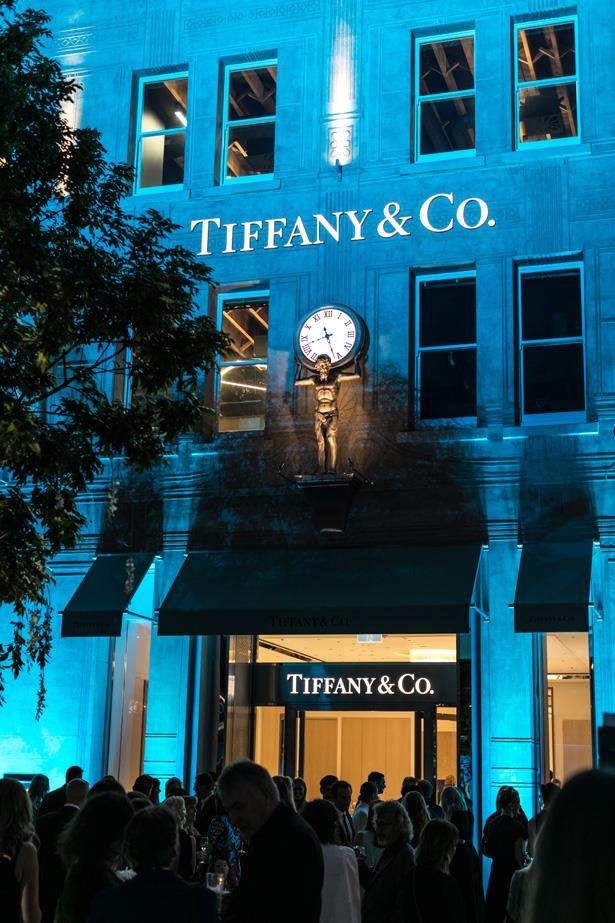 Guests enjoyed the warm evening outside the blue-lit store.