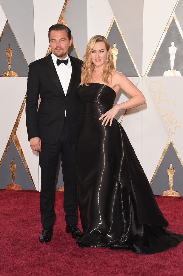 <em>Titanic</em> co-stars Leonardo DiCaprio and Kate Winslet at the Academy Awards earlier this year.