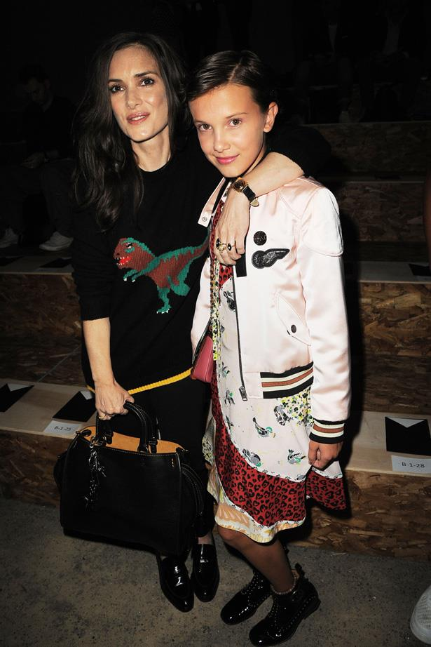 <em>Stranger Things</em> stars Winona Ryder and Millie Bobby Brown at the Coach show in New York in September.