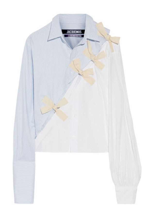 """<a href=""""https://www.net-a-porter.com/au/en/product/757695/jacquemus/bow-embellished-cotton-oxford-and-poplin-shirt"""">Shirt, $514, Jacquemus at net-a-porter.com. </a>"""