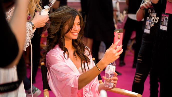 As the Victoria's Secret models strut their way down the runway with their signature bombshell curls in tow, we'd be lying if we said we weren't getting a decent amount of hair envy. But envy no more, because the woman behind the legendary beauty look, Beachwaver founder Sarah Potempa, is dishing out her eight top tips for runway ready hair and we're taking notes.