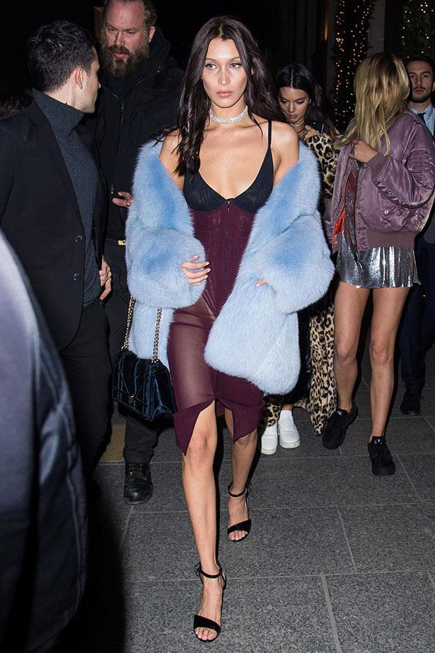 After walking in the 2016 Victoria's Secret Fashion Show, Bella Hadid proves she's officially converted to the underwear-as-outwear trend with this sexy shift ensemble.