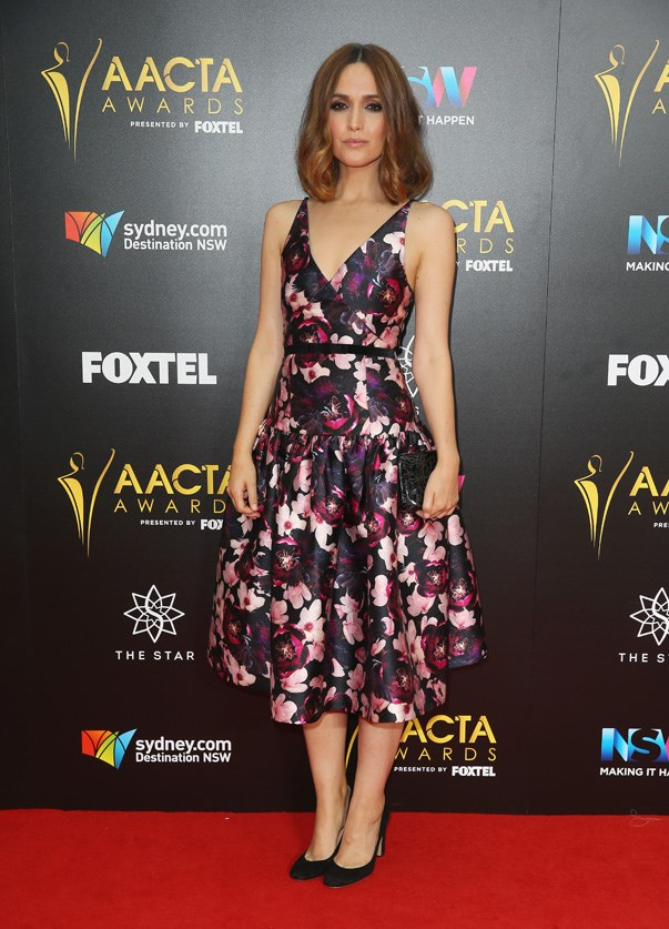 <p>Rose Byrne in Romance Was Born, carrying Oroton.