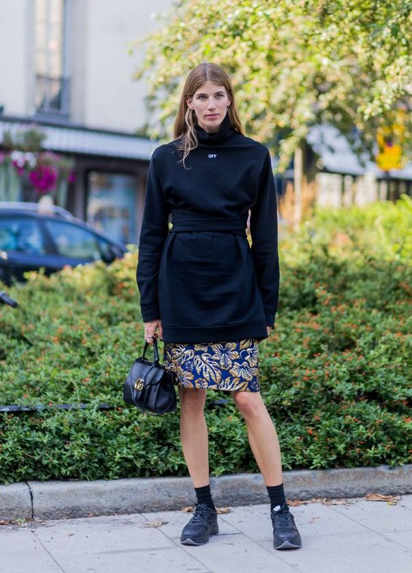 A bright skirt, a Gucci handbag, socks and trainers. Tick.