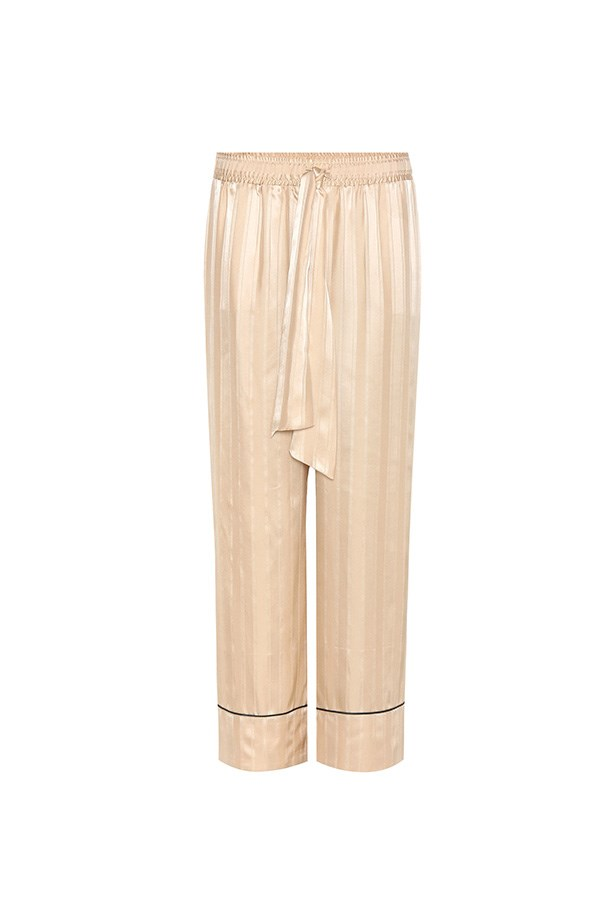 "<strong>Buy:</strong><br><br> Ganni silk trousers, $355, <a href=""http://www.mytheresa.com/en-au/kendal-silk-trousers-712203.html?catref=category"">My Theresa</a>"