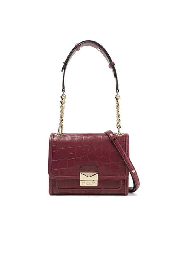 "Karl Lagerfeld bag, was $915, now $458, <a href=""https://www.net-a-porter.com/au/en/product/728465/karl_lagerfeld/mini-croc-effect-leather-shoulder-bag"">Net-a-Porter</a>"
