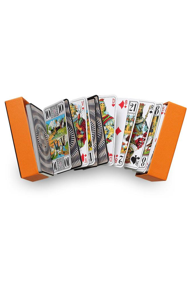 """Impress and entertain guests with personal Tarot readings at the end of the night (wine optional but recommended).<br><br> <a href=""""http://australia.hermes.com/house/games/tarot-cards/jeu-de-tarot-l-effet-domino-tranche-argent-92652.html"""">Tarot Cards, $170, Hermès</a>"""
