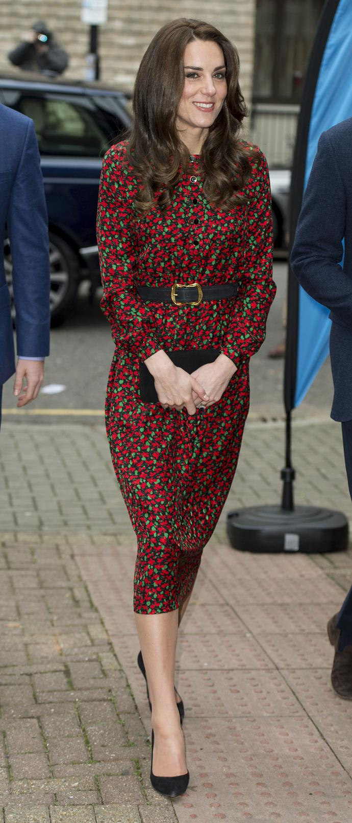 The Duchess of Cambridge attends a Christmas party for volunteers at The Mix youth service wearing Vanessa Seward on 19 December 2016.
