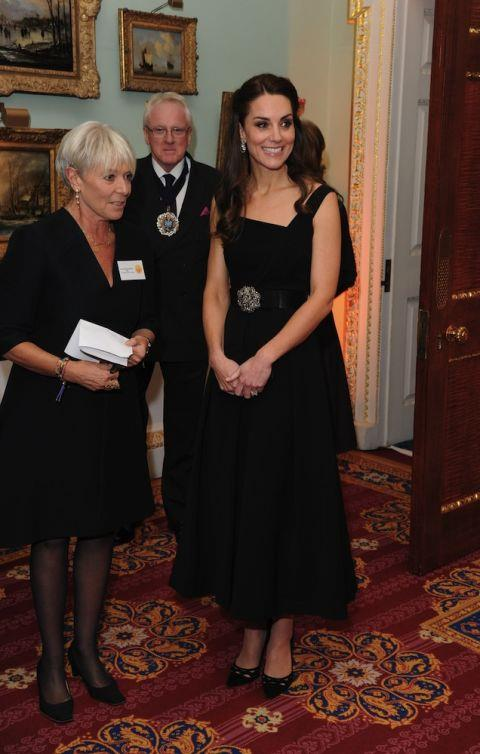 In a black dress by Preen and Prada shoes for the Place2Be Wellbeing in Schools Awards on November 22nd, 2016.