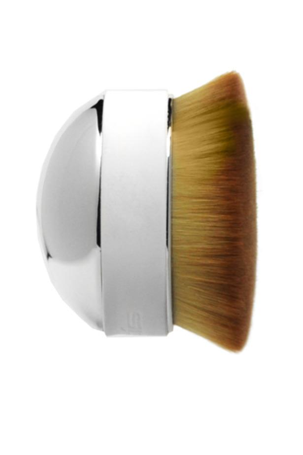 """<strong>The Palm Brush</strong> Face palming is actually a makeup technique now. The<a href=""""https://www.youtube.com/watch?v=zYghu1lNvRk""""> Palm Brush</a> is the latest creation from Artis, the brand responsible for the oval-shaped makeup brush trend. The theory is, holding a brush in the palm of your hands makes for a smoother application and an airbrush finish. <a href=""""https://www.net-a-porter.com/us/en/product/808734/Artis_Brush/elite-mirror-palm-brush"""">The Artis Palm Brush, $65</a>"""