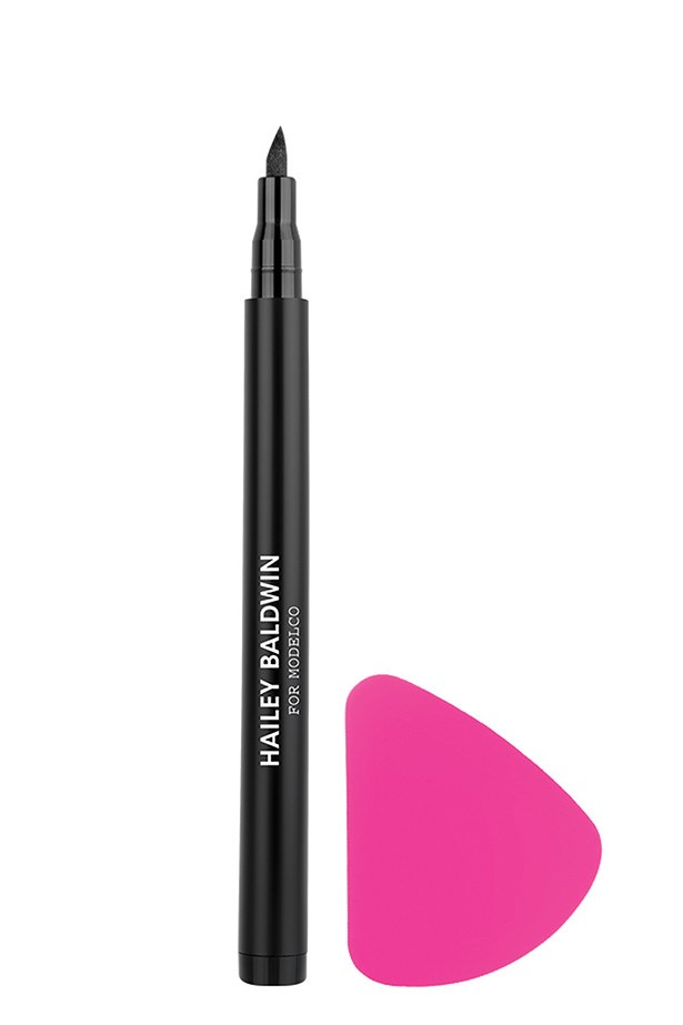 "<strong>The Winged Liner Specialist</strong> Gone are the days of using washi tape to perfect winged liner. There's teeny tiny plastic chip for that. Simply press it against the outer corner of your eye just above the cheekbone to master two perfectly symmetrical feline flicks in ten seconds flat. <a href=""https://www.modelcocosmetics.com/shop/hailey-baldwin-for-modelco/eyes-641"">ModelCo Hailey Baldwin Feline Kit Liquid Eyeliner and Applicator Tool,$59</a>"