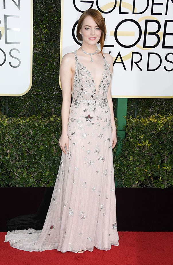 <p>Emma's Valentino dress was aptly covered in stars when she won the Best Actress in a Comedy or Musical Award at the Golden Globes.