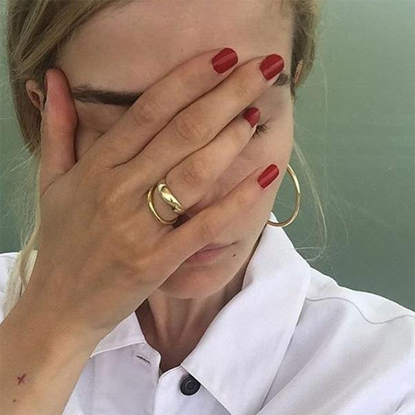 "Stick to simple gold hardware and don't go too overboard - a pair of mid-sized hoops and a single ring is understated and cool-as-hell. <br><br> Image: Instagram <a href=""https://www.instagram.com/p/BHMywS4ho33/?taken-by=grau__"">@grau__</a>"
