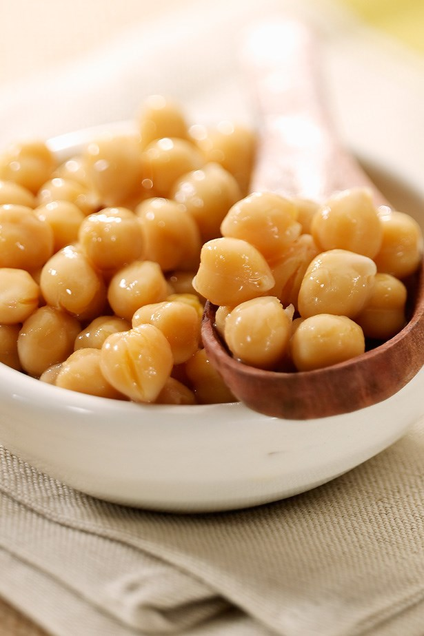 <strong>A small can of chickpeas</strong> Chickpeas are a simple, plant-based protein and a fibre-rich snack, which will help reach your daily fibre target.  Blend chickpeas with good quality olive oil, a pinch of turmeric, some crushed garlic and salt and pepper for a healthy plant-based dip. Chickpeas come in 95g cans, which is an optimal single serving size for work.