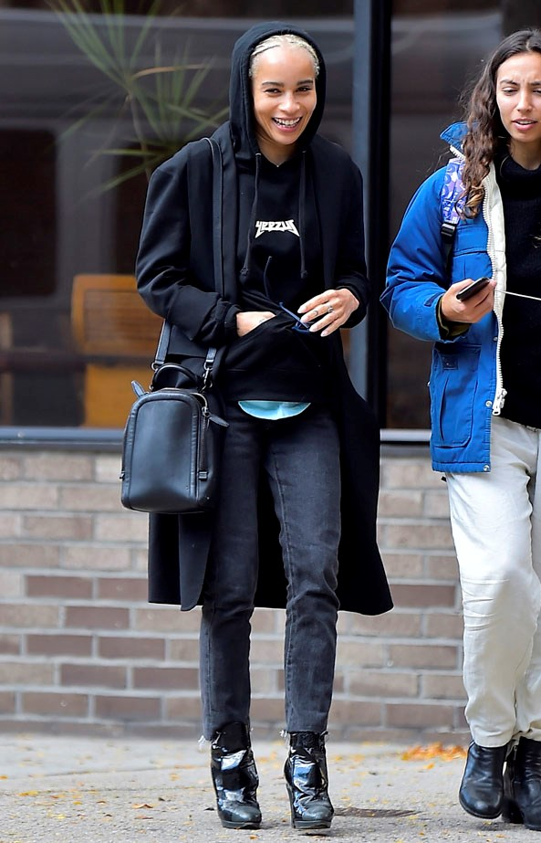 Kravitz layering up in the cold in a Yeezy hoodie.