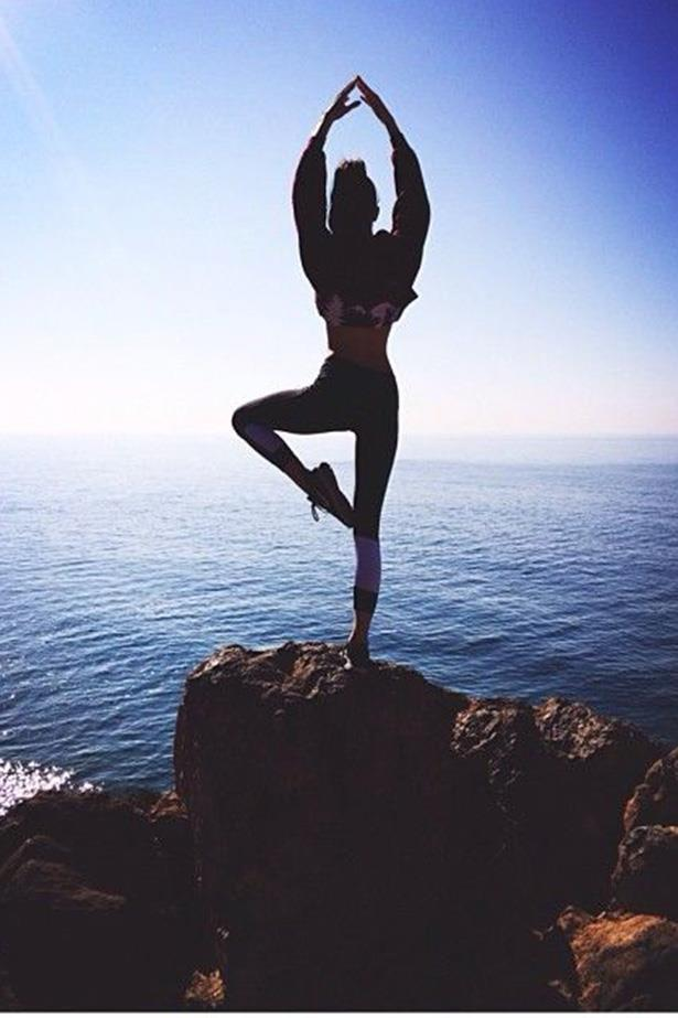 """<strong>Hatha</strong> <br> <br> """"Hatha"""" is a term that describes all the physical practises of yoga (all classes involve a form of it), but you'll find when a class is listed as """"Hatha"""" at your local gym, it's likely to be slow-paced, focusing on stretches and breathing exercises. The movements might be low impact, but you'll still feel a burn the next day, and each pose acts as an individual stress-buster. <br> <br> <em>@KendallJenner</em>"""