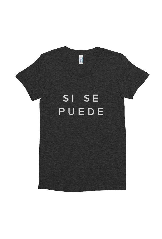 """<p> Tee, approx. $42, <a href=""""https://www.the-outrage.com/collections/t-shirts/products/si-se-puede-t-shirt"""">The Outrage</a>.<p> <p> 15% of the proceeds go to <a href=""""https://www.plannedparenthood.org/"""">Planned Parenthood</a>. <p> ('Si se puede', meaning 'Yes, I can'.)"""