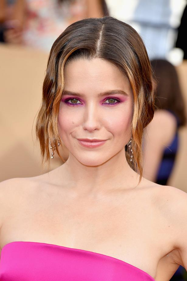 <strong>Sophia Bush</strong> <br> <br> Sophia's usually one for a smokey eye and a creamy nude lip, but clearly not today. The fuchsia pink shadow, extending above the socket line, is paired with purple kohl liner along the waterline. It's insanely '80s, but somehow, matched with a nude lip and an equally loud pink dress, it works.