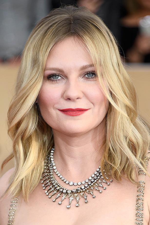 <strong>Kirsten Dunst</strong> <br> <br> Looking all loved up in a dusty red lip and loose waves.