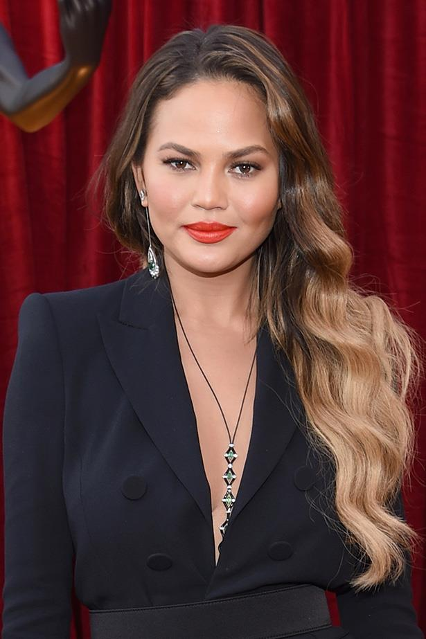 <strong>Chrissy Teigan</strong> <br> <br> That creamy coral lip makes Chrissy's eyes and subtle contouring POP. Also, we want to go ombre again after seeing how effortless these multi-toned waves look.
