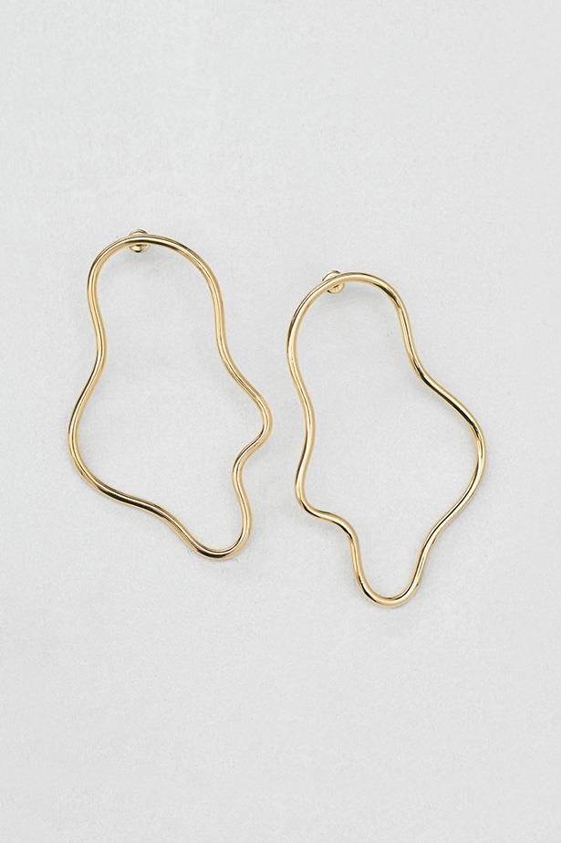 "Limited Edition The Undone X Holly Ryan Elongated Squiggle Earrings, $480, at <a href=""http://https://www.theundone.com/products/holly-ryan-gold-elongated-squiggle-earrings?variant=36044112906"">The Undone</a>"