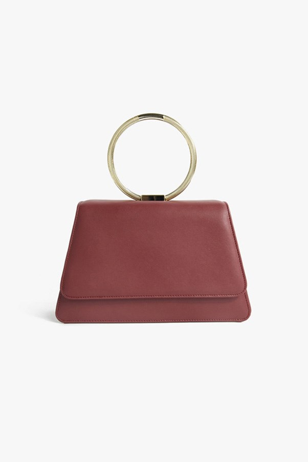 "Handbag, approx. $183 at <a href=""https://genuine-people.com/collections/bags/products/red-faux-leather-handbag?variant=16389754181"">Genuine People</a>"