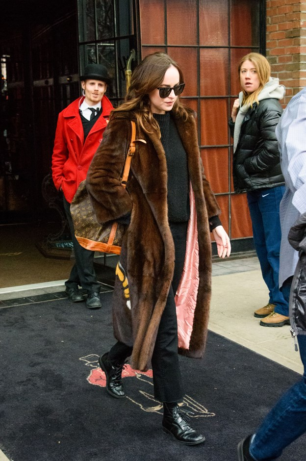 Dakota stepped out in this brown fur Gucci coat, but, of course, the best detail was on the back...