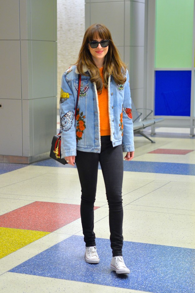 Who knew Gucci's signature customised denim jacket and a pumpkin-orange jumper would have worked? (Dakota, obviously.)
