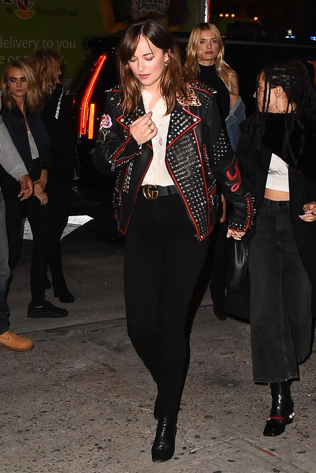 This studded leather jacket, black jeans, and Gucci logo belt combo is haunting us in the best possible way.