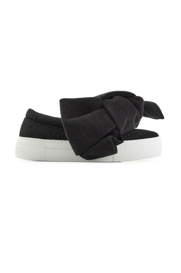 "Joshua Sanders Felted Wool Platform Slip On With Bows, $415 at <a href=""https://www.stylebop.com/en-de/women/felted-wool-platform-slip-on-sneakers-with-bows-260124.html"">Stylebop</a>."