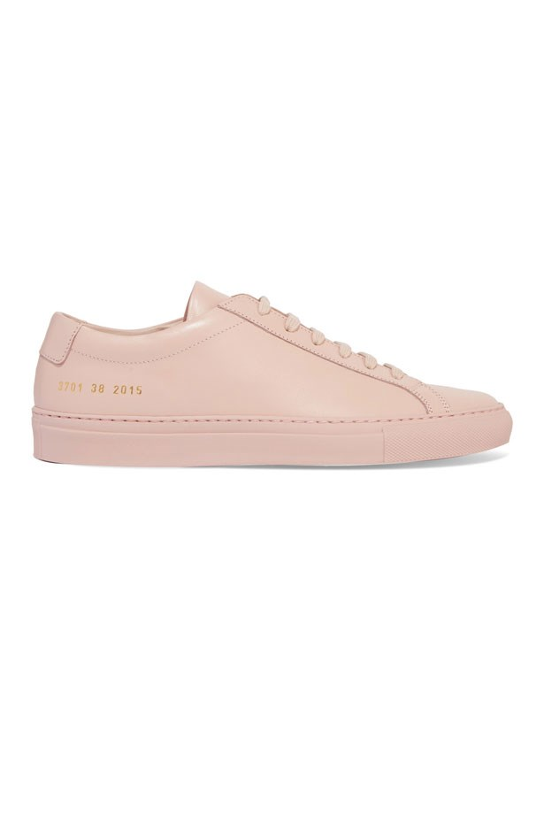 "Sneakers, $540, Woman By Common Project at <a href=""https://www.incu.com/products/achilles-three-strap-blush"">Incu</a>."