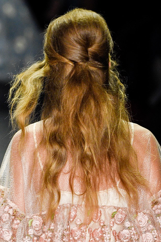 Let's not forget about the beehive. Loosely clasped with bobby pins at the back, she proved even the most laid-back style maven can pull this '60s style off.