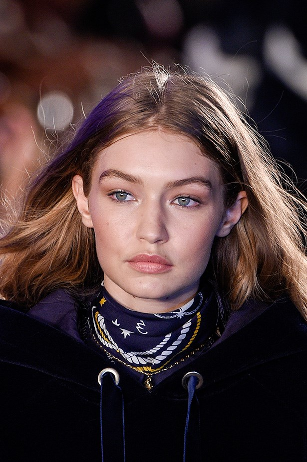 """<a href=""""null""""></a>No makeup makeup was her beauty vibe for her Gigi X Tommy collection debut, staying true to her everyday style."""