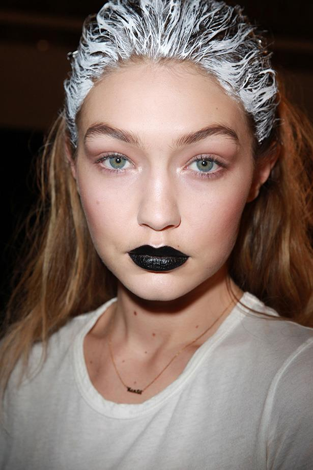 Gigi made her mark in  midnight lipstick on the Fenty Puma by Rihanna AW16 runway, proving she can pull off 'goth glam' just as effortlessly as 'Cali beach babe'.