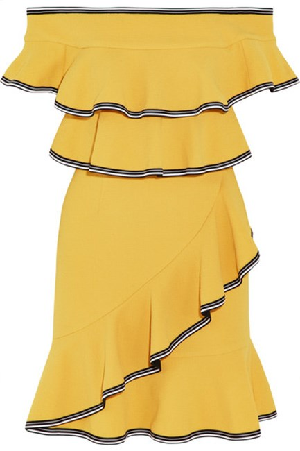 """Rebecca Vallance's ruffled off-the-shoulder-number is making us feel happier just by looking at it. Mini dress $599, at <a href=""""https://www.net-a-porter.com/au/en/product/818085/Rebecca_Vallance/courtside-off-the-shoulder-ruffled-stretch-cloque-mini-dress"""">Net-A-Porter.</a>"""