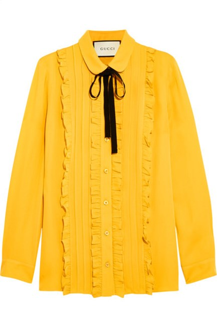 """Gucci's bold shirt is an effortlessly chic way to wear the colour. Ruffled silk shirt, $1,495 at <a href=""""https://www.net-a-porter.com/au/en/product/714638/Gucci/ruffled-silk-shirt"""">Net-A-Porter.</a>"""