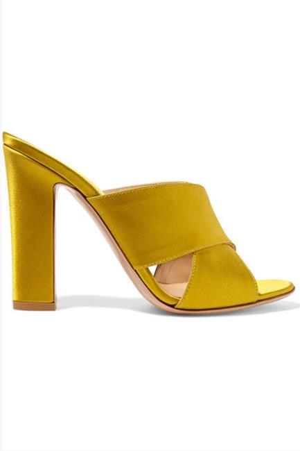 "Gianvito Rossi's mules are an ideal way to slowly introduce the colour into your wardrobe. Satin mules, $800, <a href=""https://www.net-a-porter.com/au/en/product/791081/Gianvito_Rossi/satin-mules"">Net-A-Porter.</a>"