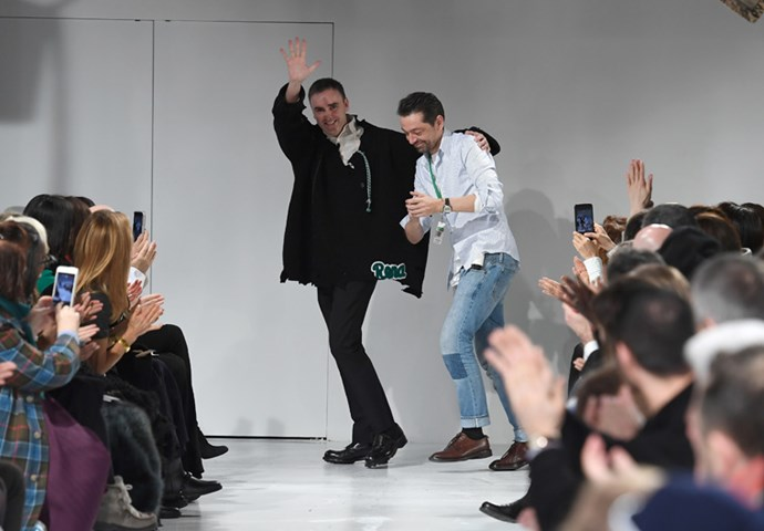 <p>Raf Simons and creative director Pieter Mulier take a bow.
