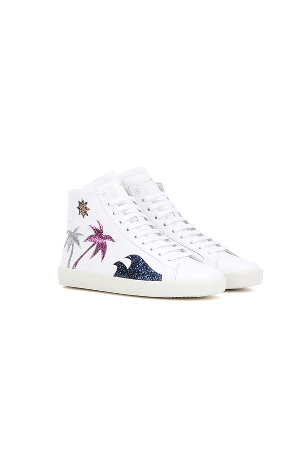 "Sneakers, $605, Saint Laurent at <a href=""http://www.mytheresa.com/en-au/embellished-leather-sneakers-640756.html?catref=category"">My Theresa</a>"