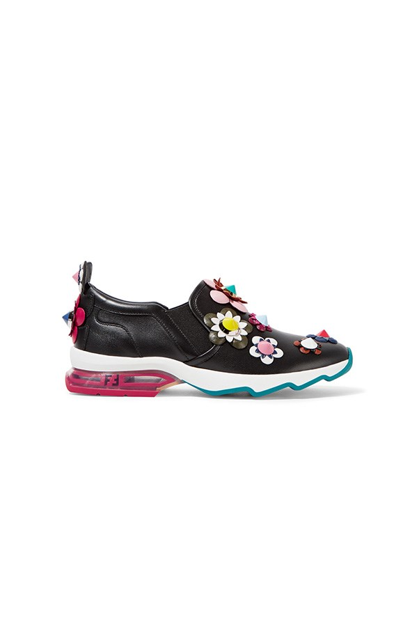 "Sneakers, $1,530, Fendi at <a href=""https://www.net-a-porter.com/au/en/product/681749/fendi/embellished-appliqued-leather-slip-on-sneakers"">Net-a-Porter</a>"